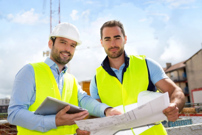 engineer and architech checking plan on construction site