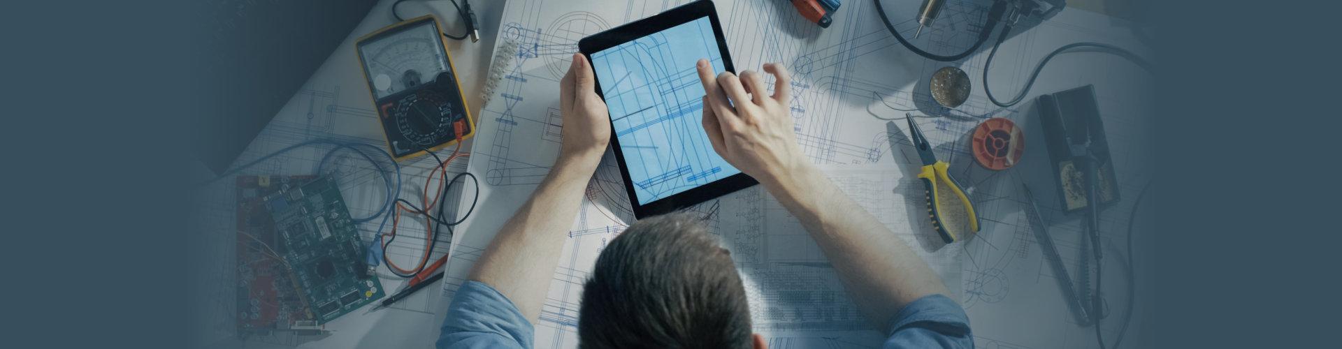 technician working on blueprints